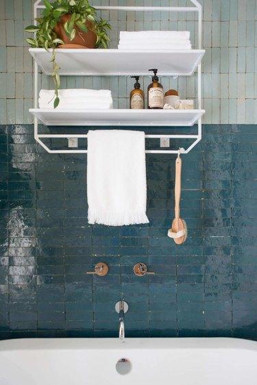 teal shower tile with light blue tile above it