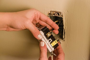 Insert the wire under the screw in the outlet.