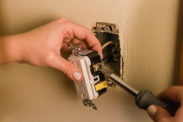 Tighten the outlet on the screw and repeat on the other side.