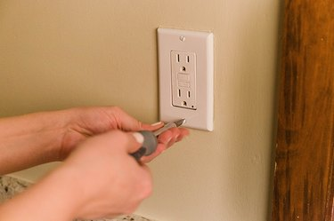 Screw on the outlet cover.