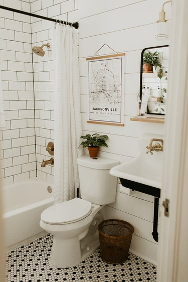 Industrial bathroom with white subway tile and white shiplap wall
