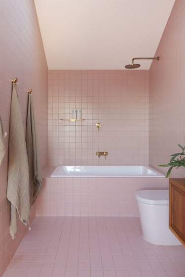 pink bathroom covered in pink tiles