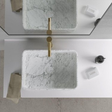 minimal bathroom with white marble bathroom sink