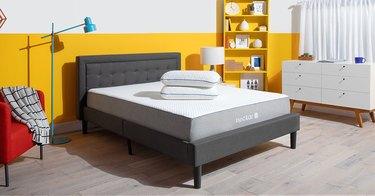 tufted bedframe in bedroom