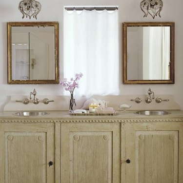 Bathroom with stainless steel bathroom sink designed by Giannetti Home