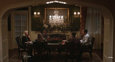 people in dining room with chandelier
