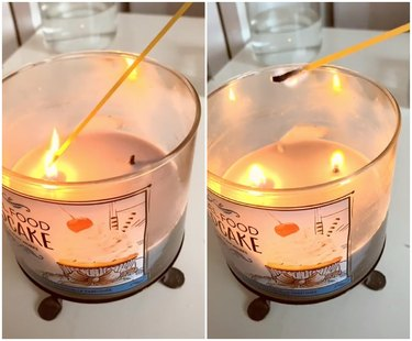 bath and body works candle being lit using strand of spaghetti