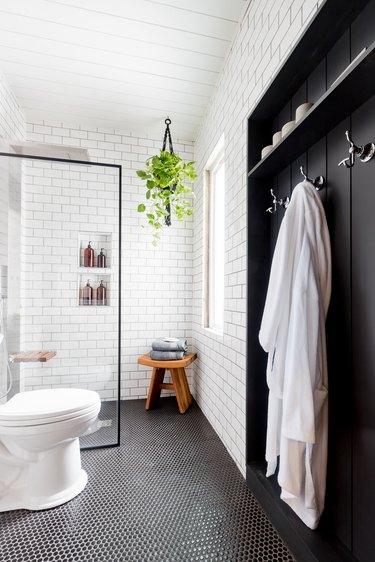 Industrial Bathroom Storage in black and white industrial bathroom with coat hooks