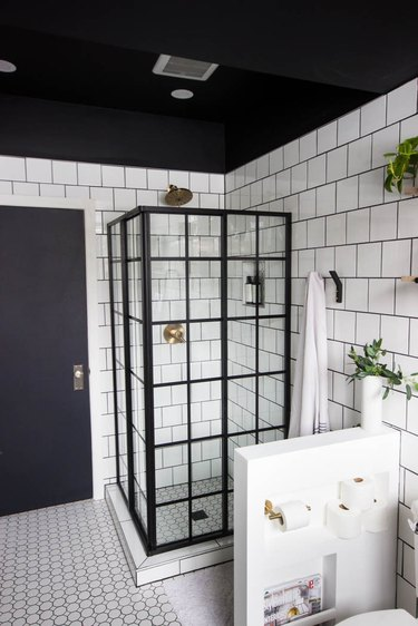 Industrial Bathroom Storage in white tiled industrial bathroom with black ceiling and clever storage