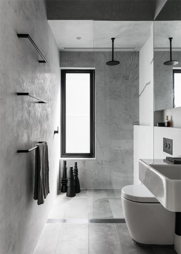 gray minimalist shower with black fixtures and hardware