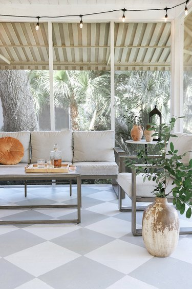 Painted gray and white checkerboard floor in sunroom