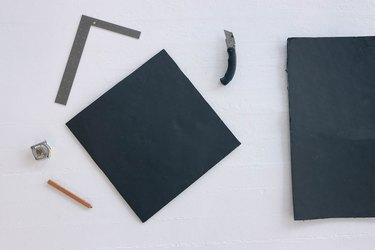Square template cut from black foam core