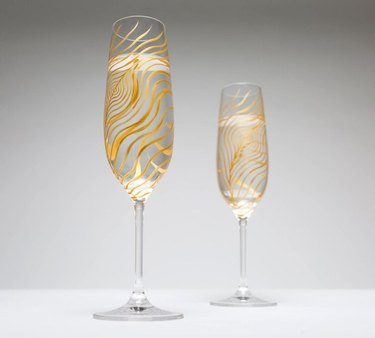 two gold champagne flutes