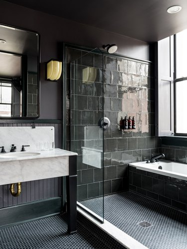 contemporary black tile shower with tub
