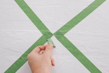 Green painter's paint on white floor
