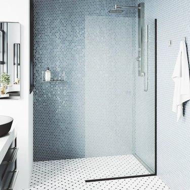 Blue shower tile seen in modern glass shower