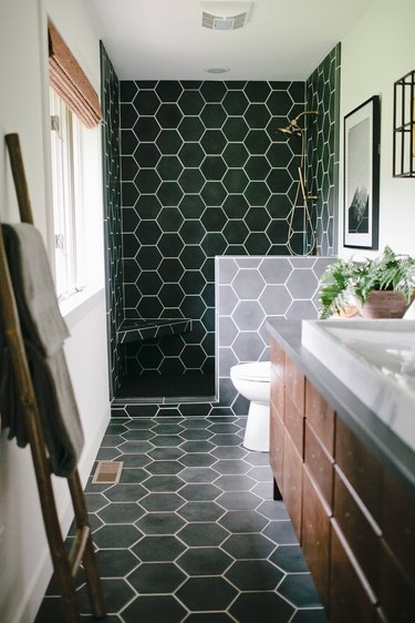 contemporary hex black tile shower with corner bench
