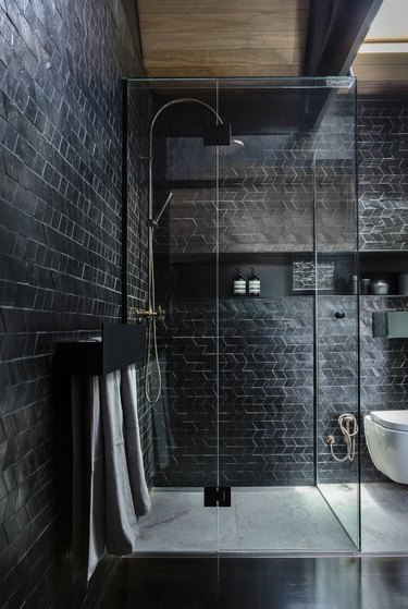 contemporary black tile shower with glass doors