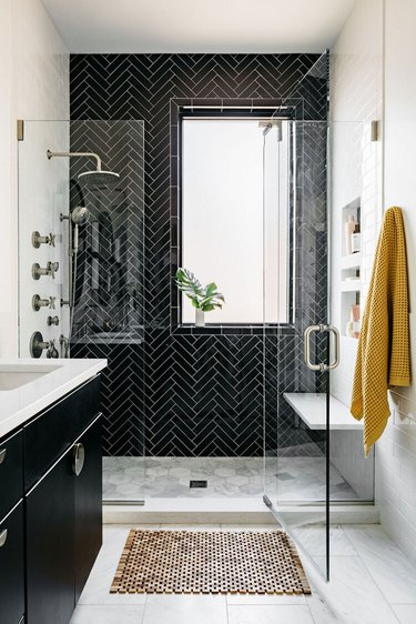 contemporary black tile shower and white walls