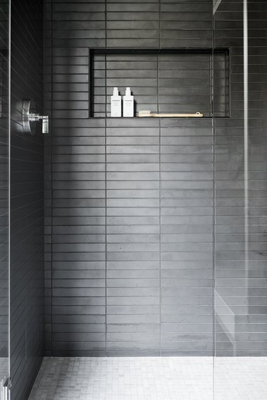 contemporary black tile shower with nook for storage