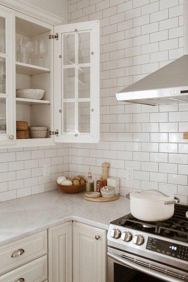kitchen subway tile backsplash and white cabinets