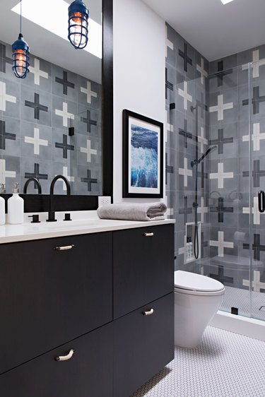 small industrial bathroom with plus sign patterned wall tile