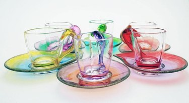 multicolored mugs with saucers