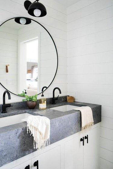 gray and white small industrial bathroom with farmhouse