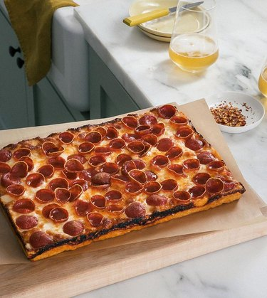 A Cozy Kitchen Detroit-Style Pizza on wood cutting board