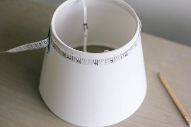 Measuring and marking dots around rim of lampshade
