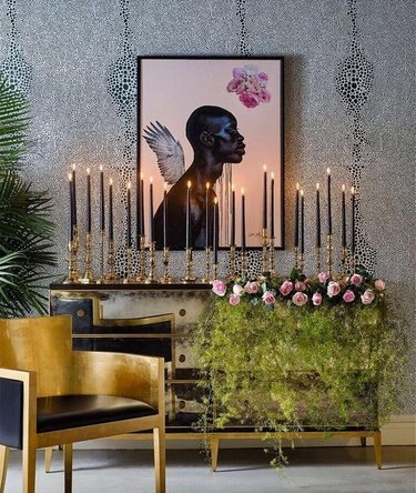keia mcswain living area with gold chair and mirrored dresser