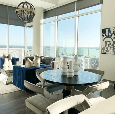 justin q. williams penthouse dining room and living room featuring whites, blues, and greys