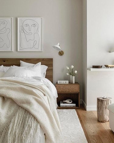 olivia stutz bedroom with white bedding and figure art