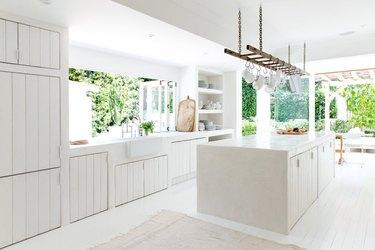 minimal white kitchen with beadboard cabinets