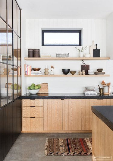 modern kitchen with wooden beadboard cabinets and open shelving