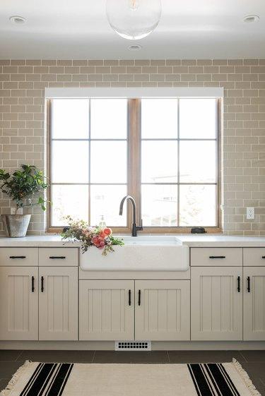 modern white kitchen with beadboard cabinet