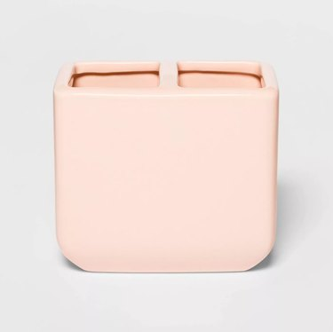 Pink toothbrush holder with two compartments