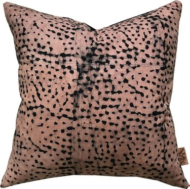 pink and black pillow
