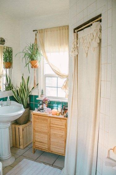 Boho Bathroom Storage in small boho bathroom with bamboo vanity