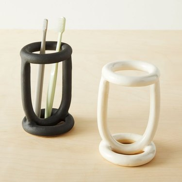 Sculptural toothbrush holders in black and white