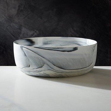 CB2 Swirl Serving Bowl on white table