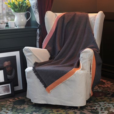 Ikea Dekorera Throw on armchair with white slipcover