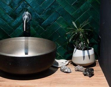 Round metal bowl sink, dark green tile backsplash and Wall-Mounted Bathroom Faucet