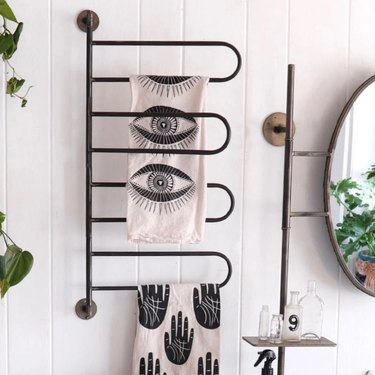 Black metal towel rack for small bathroom with modern hand towels