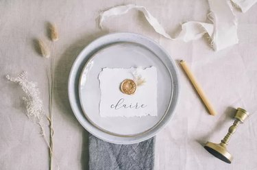 Wax seal place cards on table