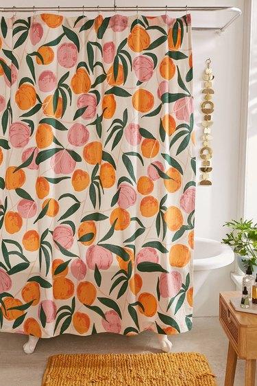 peach print shower curtain in small boho bathroom