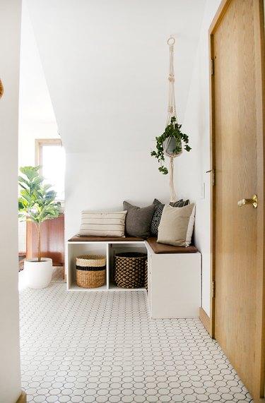 Boho Bathroom Storage in large boho bathroom with corner storage and seating unit