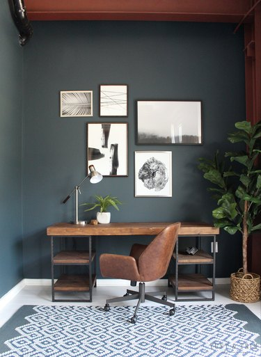 dark gray office with rustic wood desk and leather chair