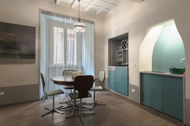 Aqua colored walls and cabinets in dining area