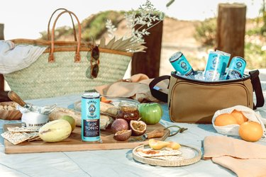 picnic scene with food and drinks